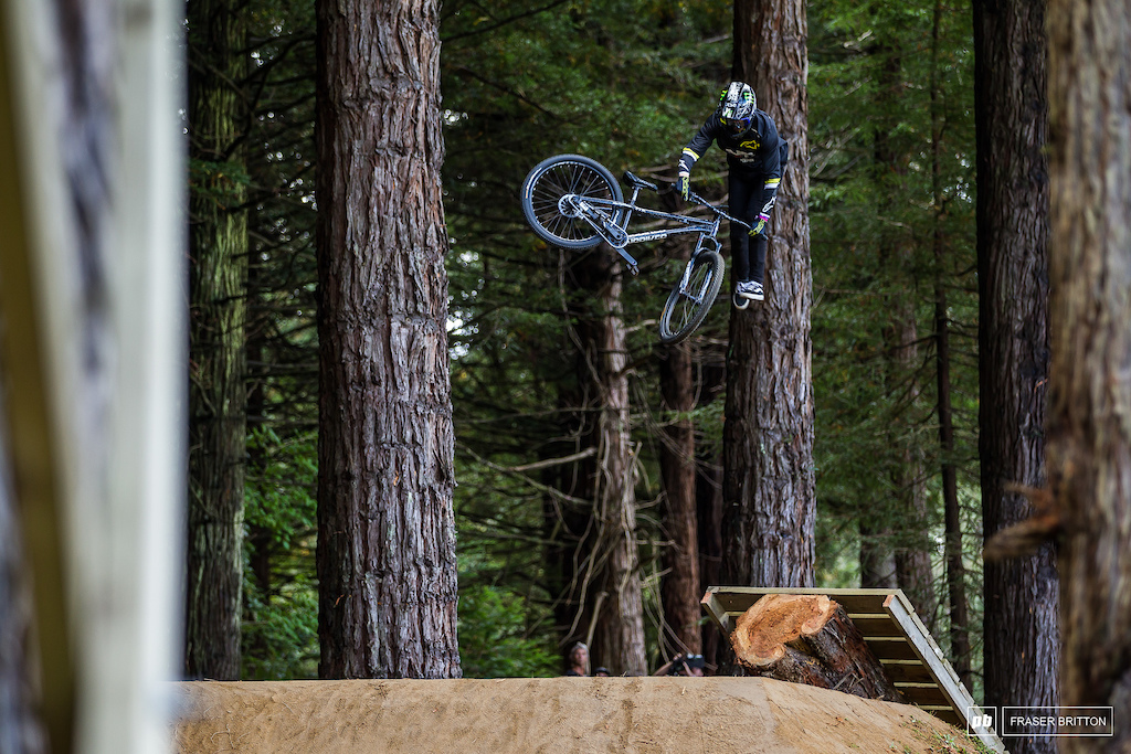 Max Fredrikksson with a tail whip off of the boner log.
