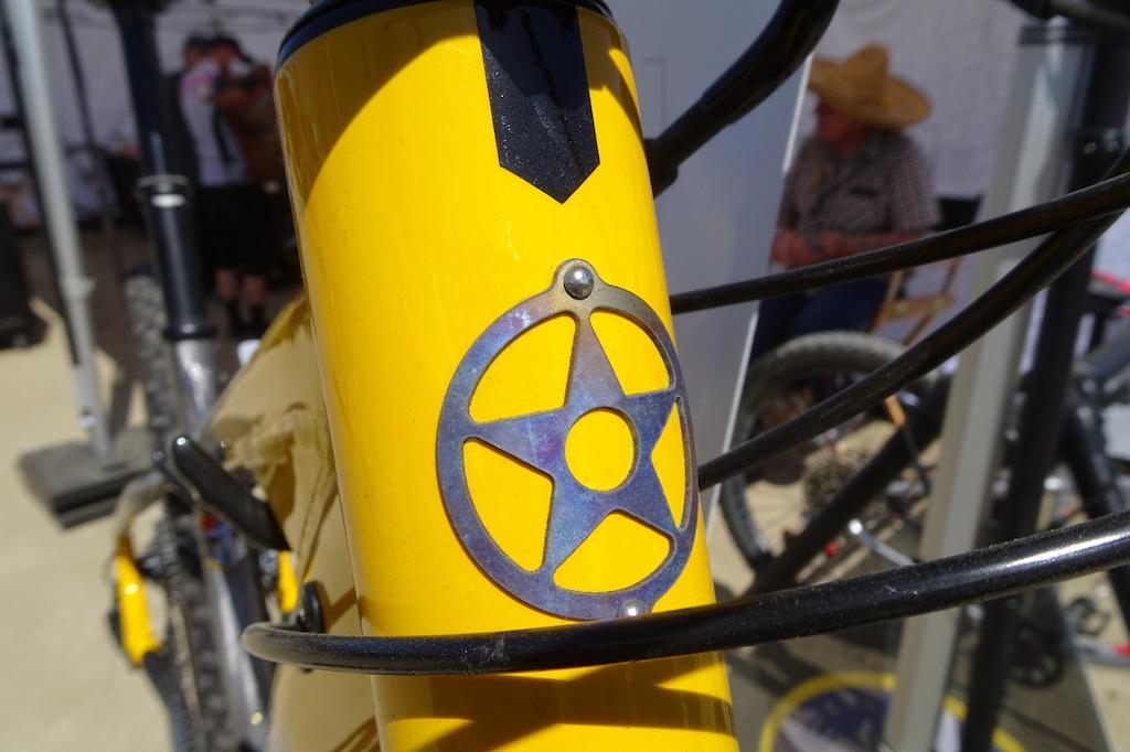 Titanium head badge.
