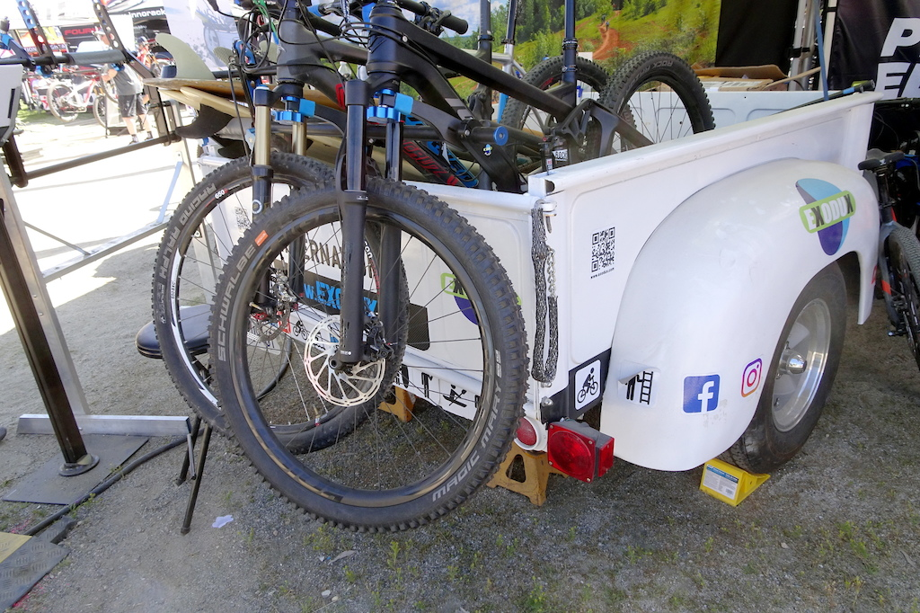 The Exodux modular bike rack stows your bikes in similar fashion as a pad but with greater security and without any contact between the bike and the truck the rear tire sits on the bed .