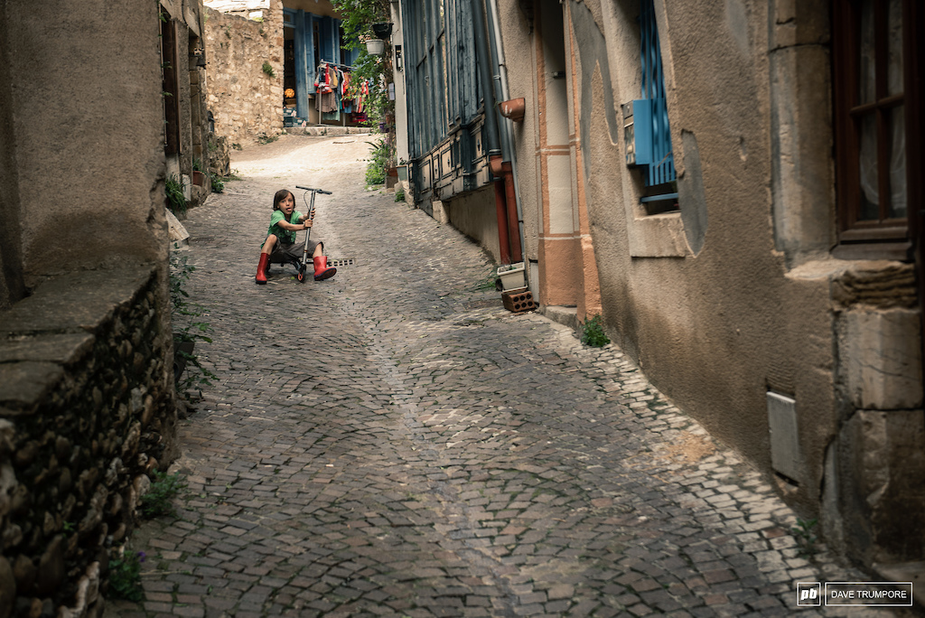 The locals are already out testing the fast lines for Stage 4 through the streets of Olargues.