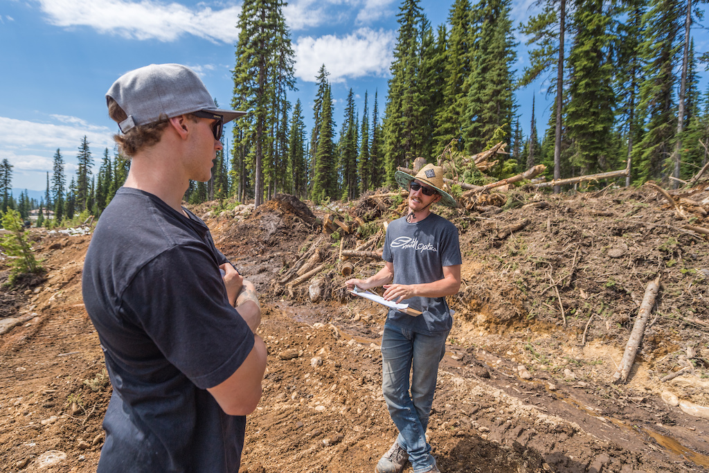 Tom and Alex from LOFT Bike Parks walk the course to get the lay of the land and plan out jumps and features