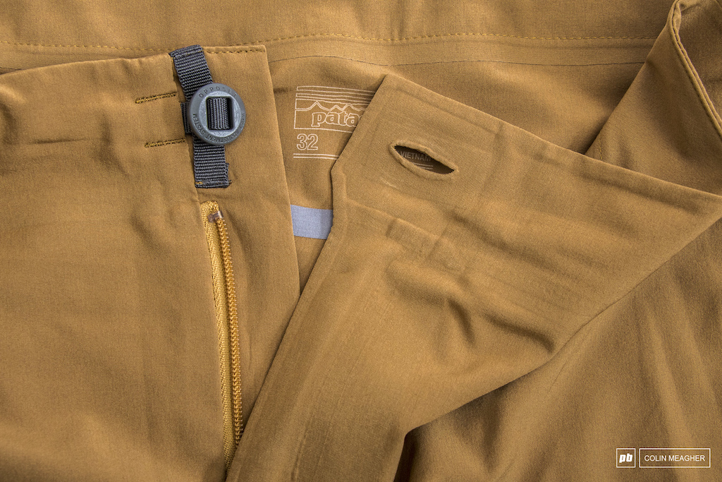 Patagonia s Dirt Roamer shorts fasten securely with a button.
