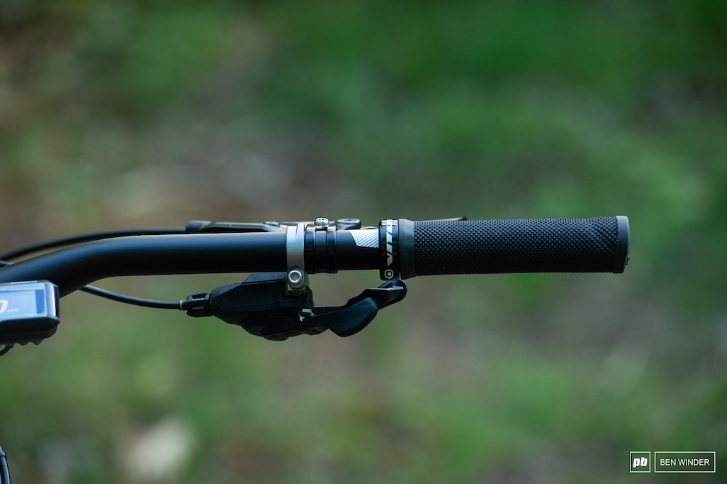 Vitus lock-on grips and Shimano XT shifter on the right.