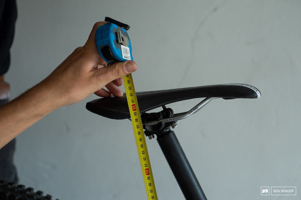 The top of his saddle is 62cm from the centre of the bottom bracket.