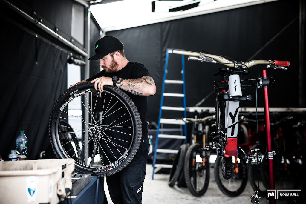 John Hall prepping wheels and tires for Aaron Gwin.