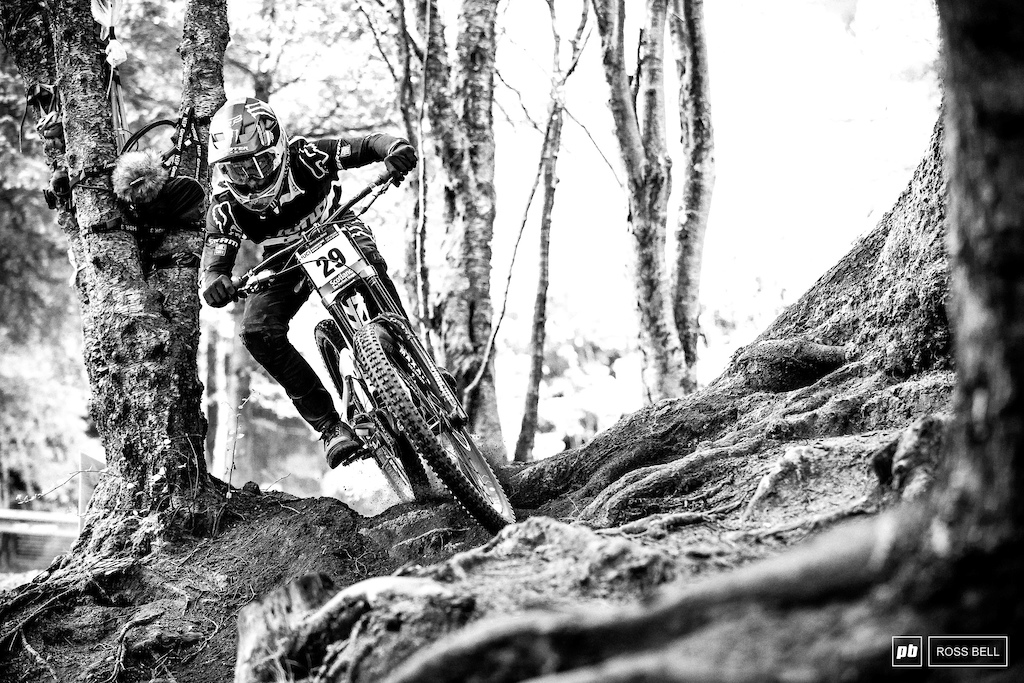 Connor Fearon threading through the very brief section of loam in the woods.