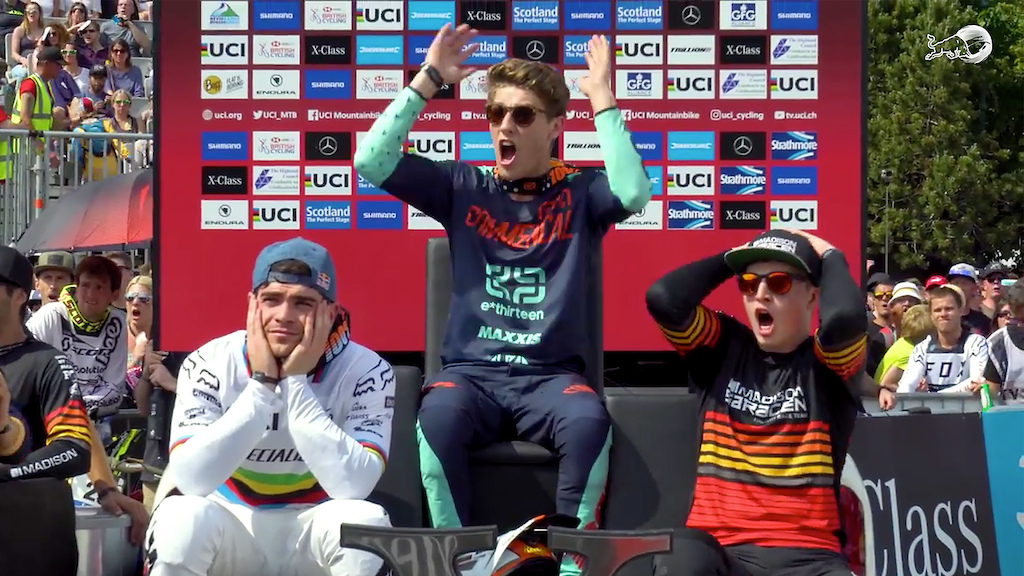 Screenshot of the podium scene at the moment Gwin crashes in the woods.