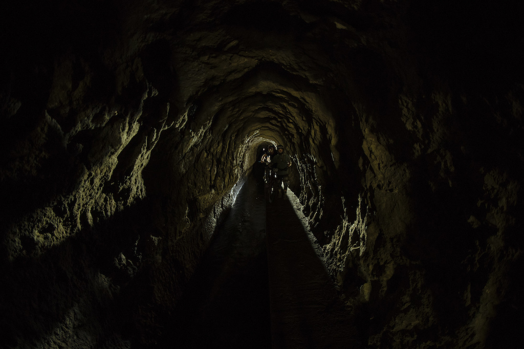 The riders had to go through two of these tunnels. As wide as your bag with a stream of water three feet deep to your side pitch black and with a cue of riders in front and behind. Adventure at its best.