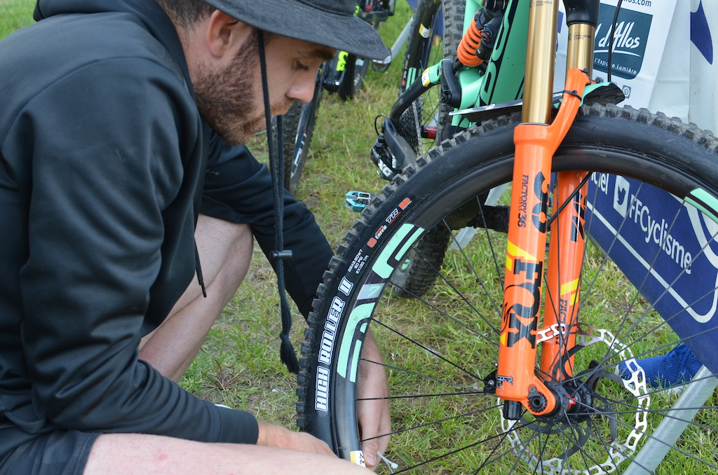 A sticker for each wheel on the frame fork and rear triangle and be sure to do it as marshals will be checking