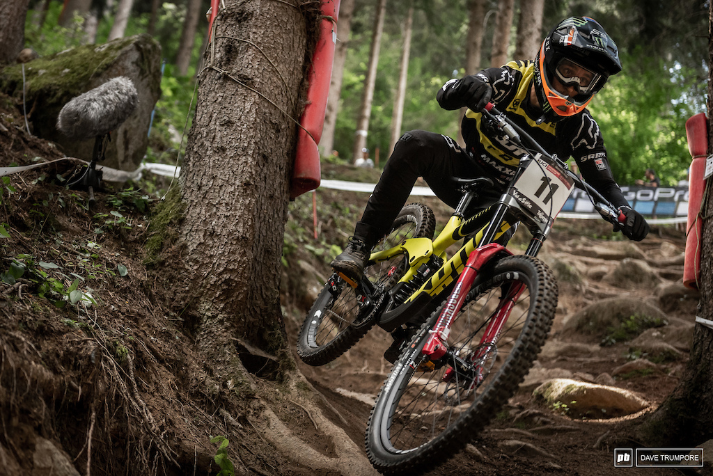 Connor Fearon using every inch of track to smooth out the big rocks and roots.