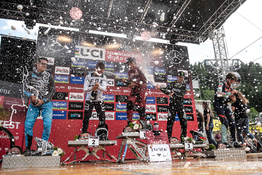 The fastest men popping bottles on the podium in Val di Sole.