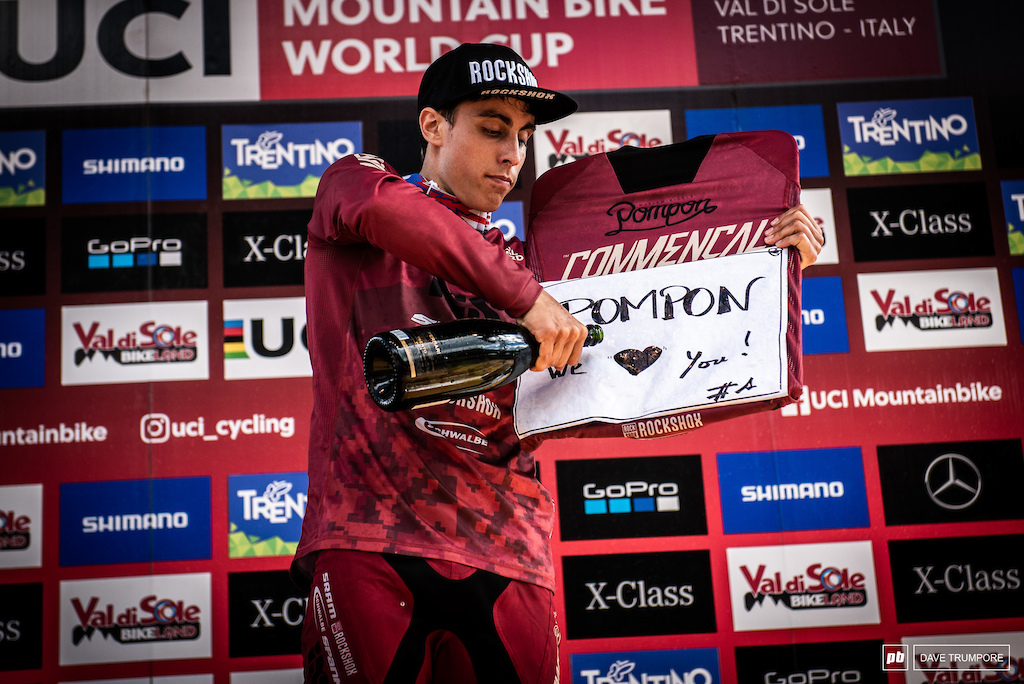 Amaury Pierron pours one out for his fallen teammate on the podium.