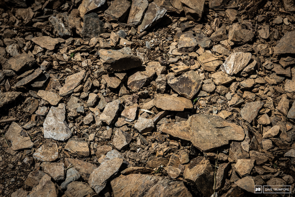 From afar the open bits look smooth, but when you get a little closer you'll see they are peppered pull of loose rocks.  come race day it will be rough and full of holes and ruts.