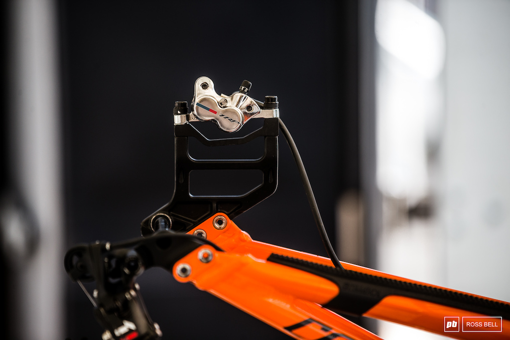 Chunky brake mounts on the Commencal 100 team bikes.