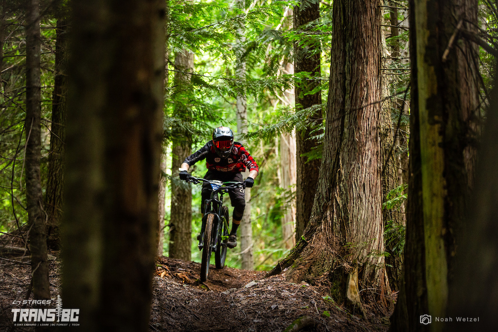 Rider races stage 1 on day 3 of the 2018 Trans BC Enduro in Castlegar BC.