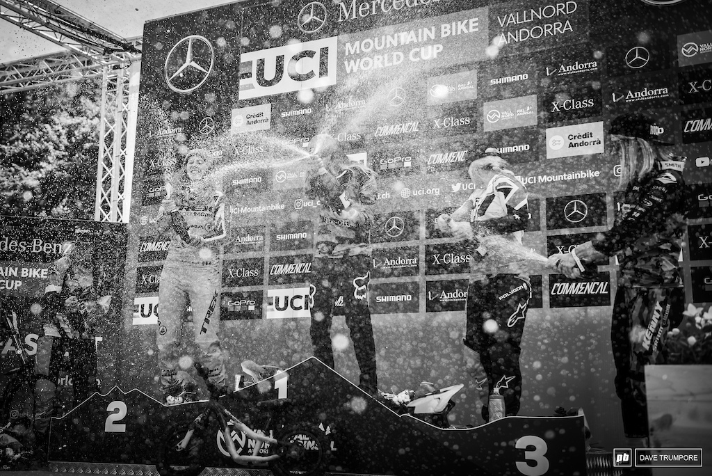 Champagne showers on the women s podium to wash the dust away after a hard fought battle