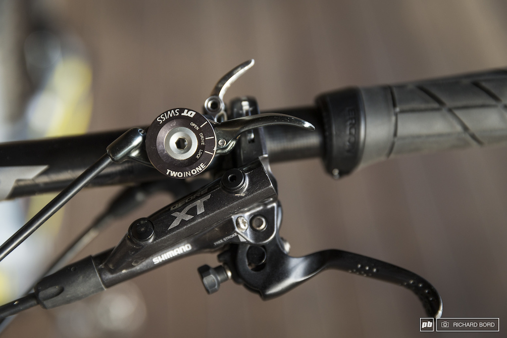 3 positions and 2 levers to control the rear shock from the bar.