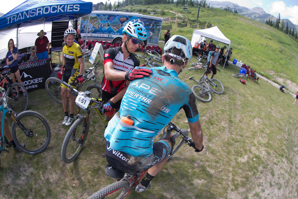 rider Justin Lindine had a flat tire and a crash and is consoled by Dylan Bailey at the finish line.