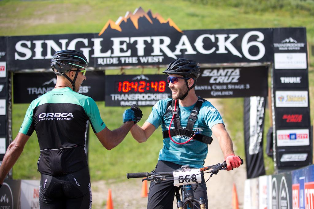 rider Tomi Misser congratulates Evan Guthrie.