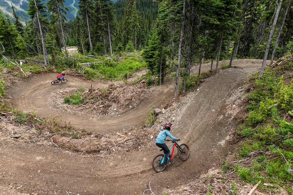 Gabe Neron and Melissa Da Silva try out the new green trail at Sun Peaks Bike Park. Photo by Reuben Krabbe.