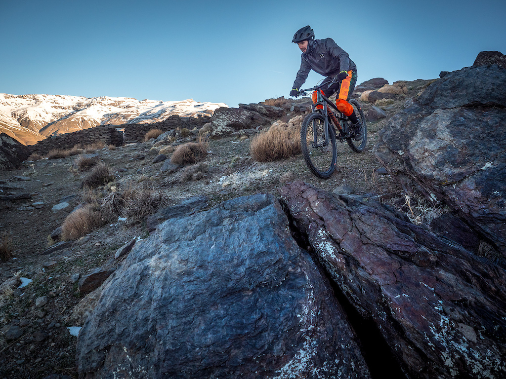 Piotr Krajewski on the 70km long ride from the peaks of the Sierra Nevada mountains to the shore of Mediterranean Sea with his Dartmoor Bluebird trail bike.