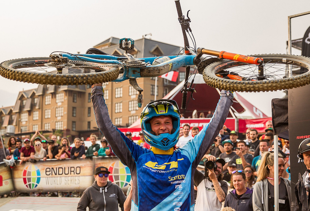 Martin holding his bike high after officially taking the win. Photo Fraser Britton