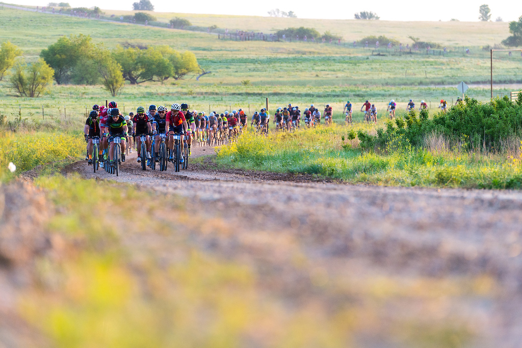 Several hundred riders spreading out over miles of Kansas gravel road as the sun rises. There were definitely some epic looking moments in this race