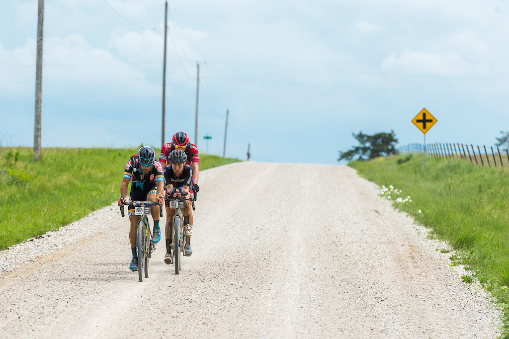 I d heard about Dirty Kanza for a few years and I thought I had a rough idea of what it would be like but nothing really prepared me for how hard it was to shoot this event. I needed to shoot photos and video covering several different Team CLIF Bar riders as well as reigning women s champ Amanda Panda Nauman and Rebecca Rusch and Kristin Taylor as well if possible. The riders were soon spread out over many miles and it soon became apparent that it would be almost impossible to get much footage of more than one rider. Menso de Jong was in the lead group of three so the decision was made to just stick with them and see how it played out. This is in the final stage of the race with maybe 15 miles left to go in the 200 mile race.
