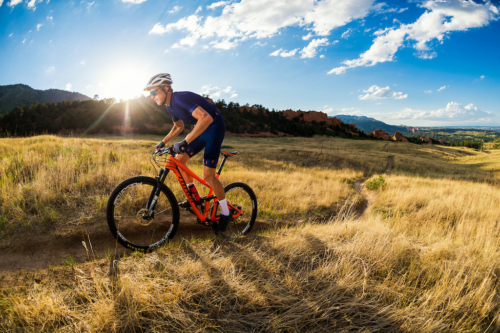 Russell Finsterwald rides his Niner RKT 9 RDO on a trail near Colorado Springs. While I used to use a lot of off camera flash in my shots I ve been getting away from it lately. In the time when I do use it now it s usually just for a little kick as in this shot.