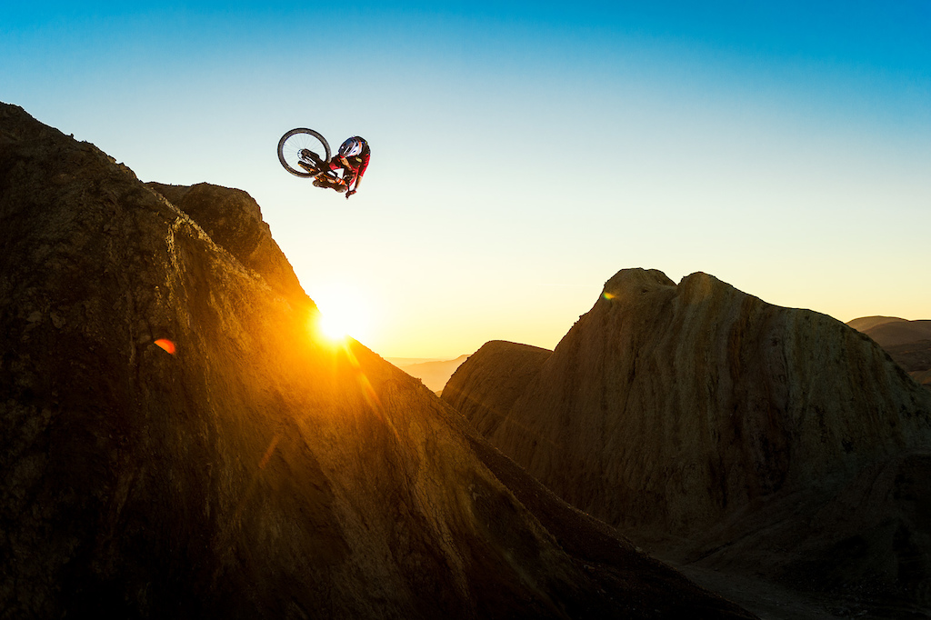 Kirt Voreis performs a table on his Niner Bikes RIP 9 RDO on a giant natural quarter pipe in the California desert.