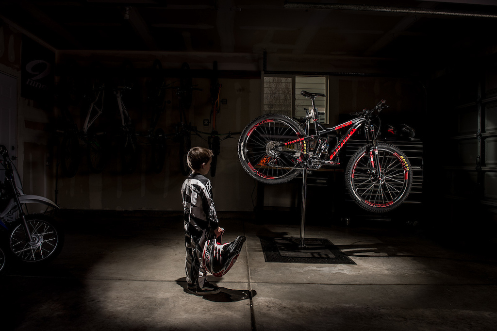 This was a concept put together to illustrate the concept of Dream Big and showed a young boy dressed in DH kit looking at his dad s bike.