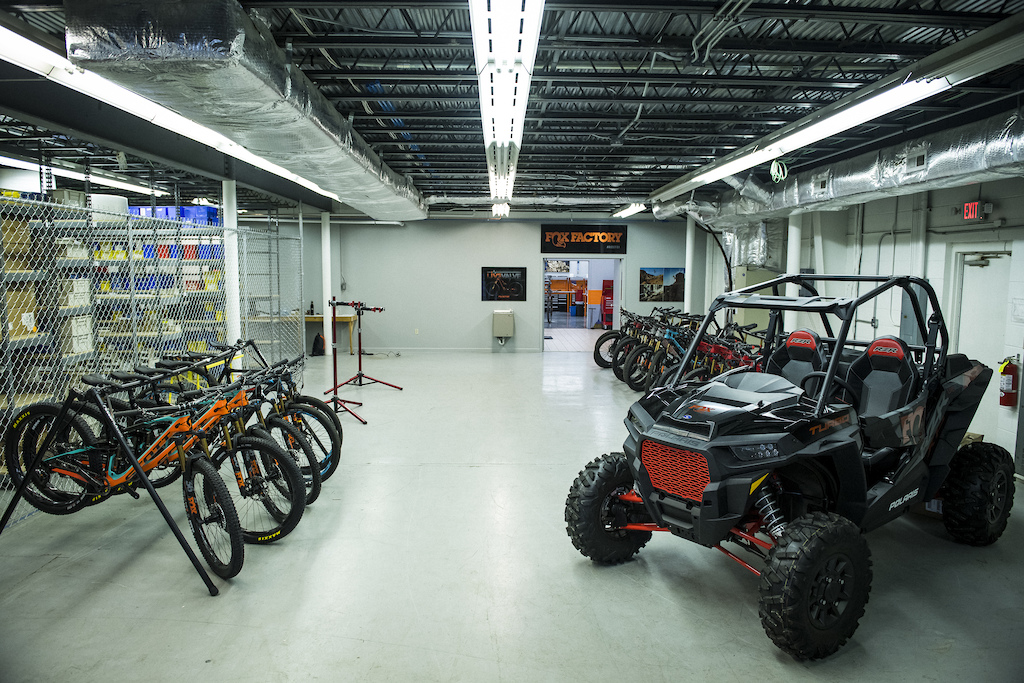 9eb2a19a522 Test bikes lined up in Fox's North Carolina service and development  facility. The Polaris RZR UTV is also Live Valve suspended. Ian Collins  photo