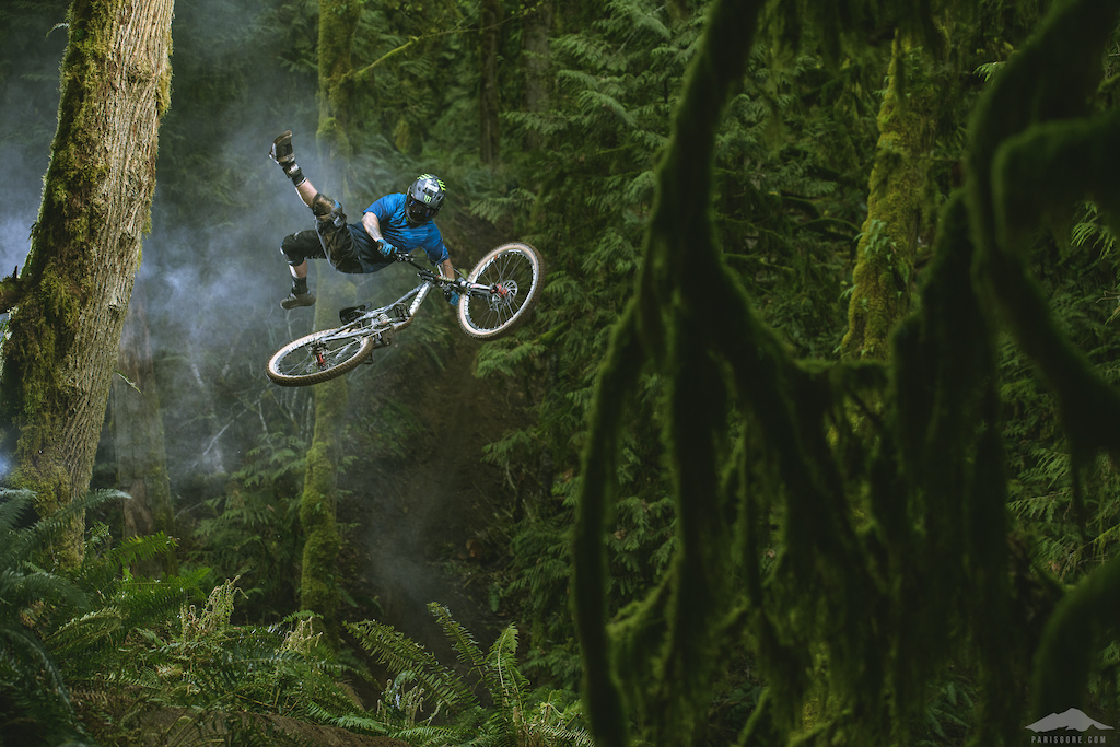 Graham Agassiz throwing a top side no can shot in the Bellingham jungle for Dakine.