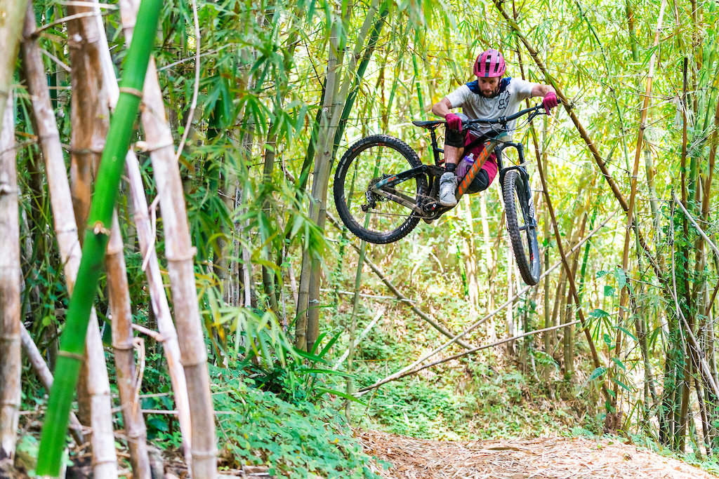 Kirt Voreis whipping hard off the bank on a trail in the Blue Mountains of Jamaica.