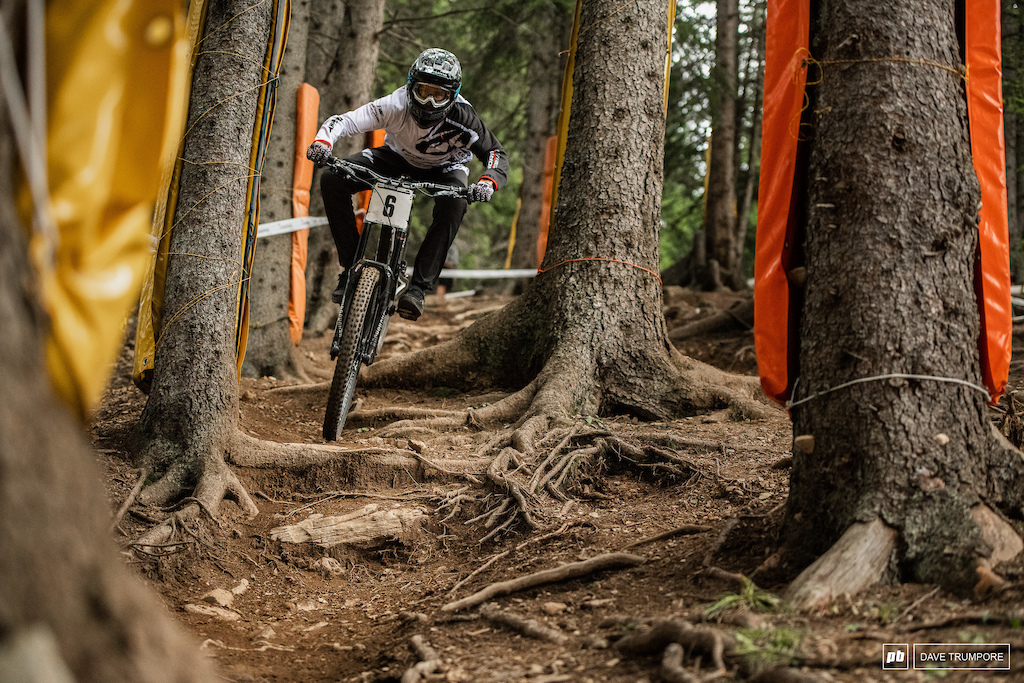 Sam Blenkinsop threads it through the tight trees at high speed.