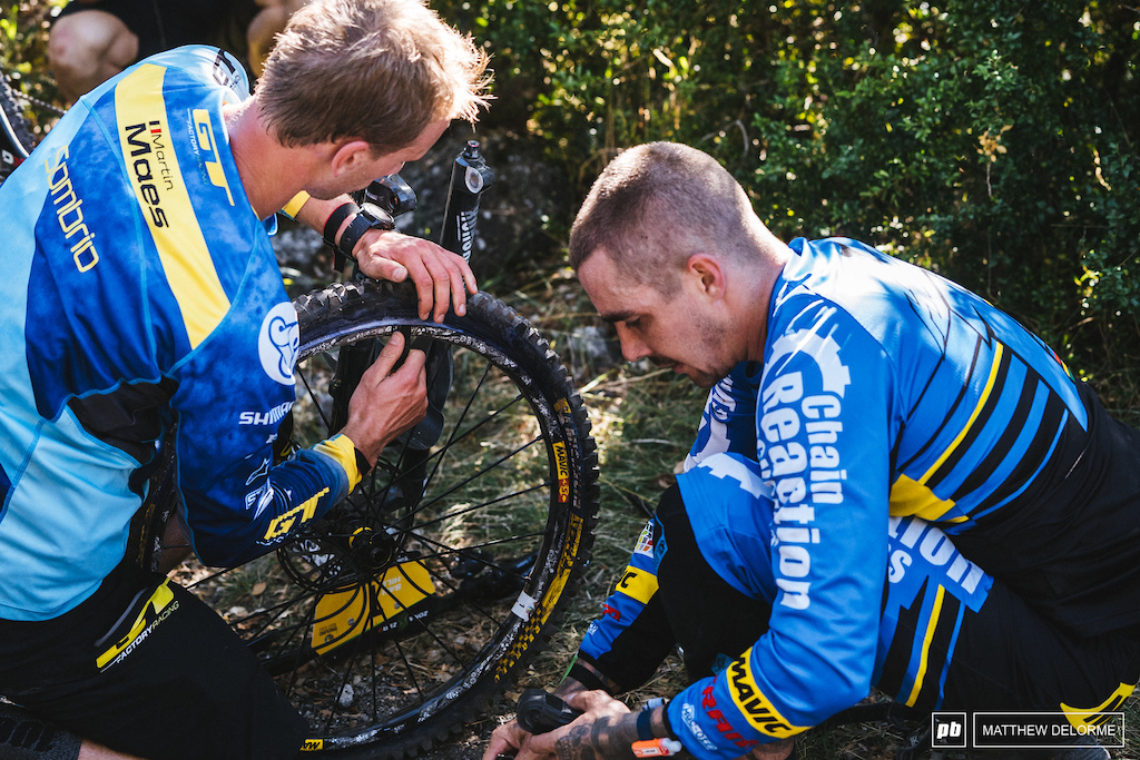 Martin Maes gives Sam a hand after a stage two front flat.