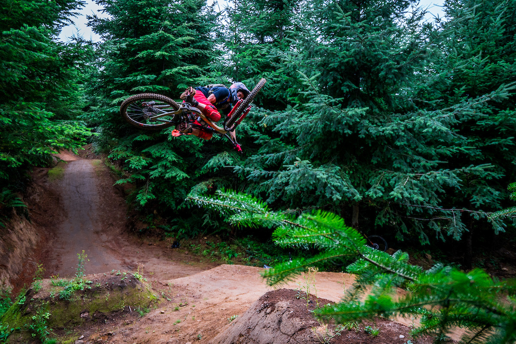 Kirt Voreis performs a table top on his mountain bike at Galbraith Mountain near Bellingham Washington.