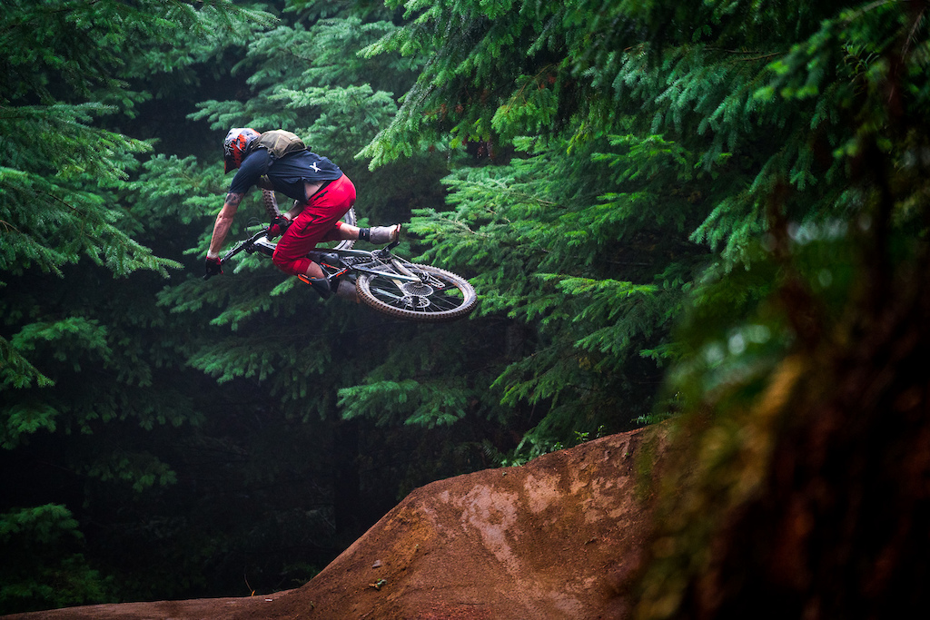 Kirt Voreis does a table top on his mountain bike at Galbraith Mountain near Bellingham, Washington.