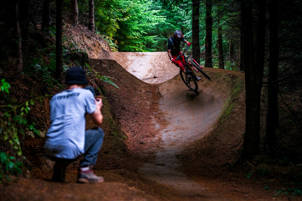 Doug Jambor films Kirt Voreis riding his mountain bike at Galbraith Mountain near Bellingham, Washington.
