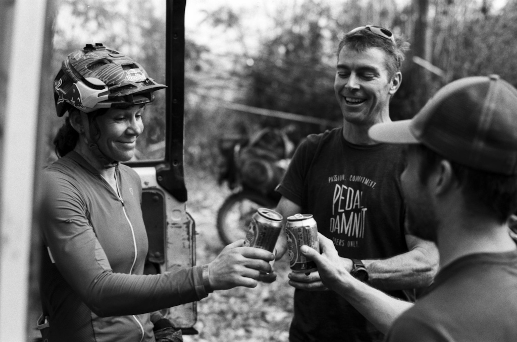 Rebecca Rusch and crew members drink a beer along the Ho Chi Minh Trail for the feature film project Blood Road in Vietnam Laos and Cambodia in March 2015. Josh Letchworth Red Bull Content Pool AP-1UD72R7HW1W11 Usage for editorial use only Please go to www.redbullcontentpool.com for further information.