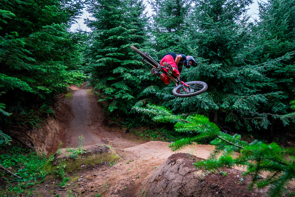 Kirt Voreis performs a table top on his mountain bike at Galbraith Mountain near Bellingham, Washington.