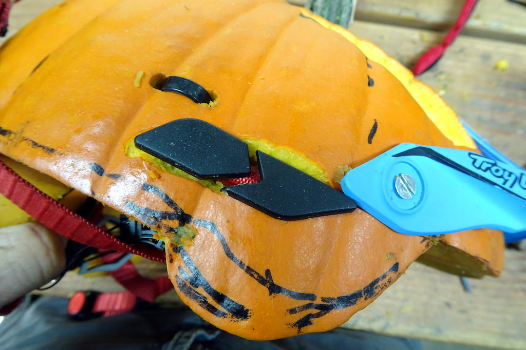6 Use zip ties and creative slots to fix the webbing from an old lid to your fresh pumpkin.