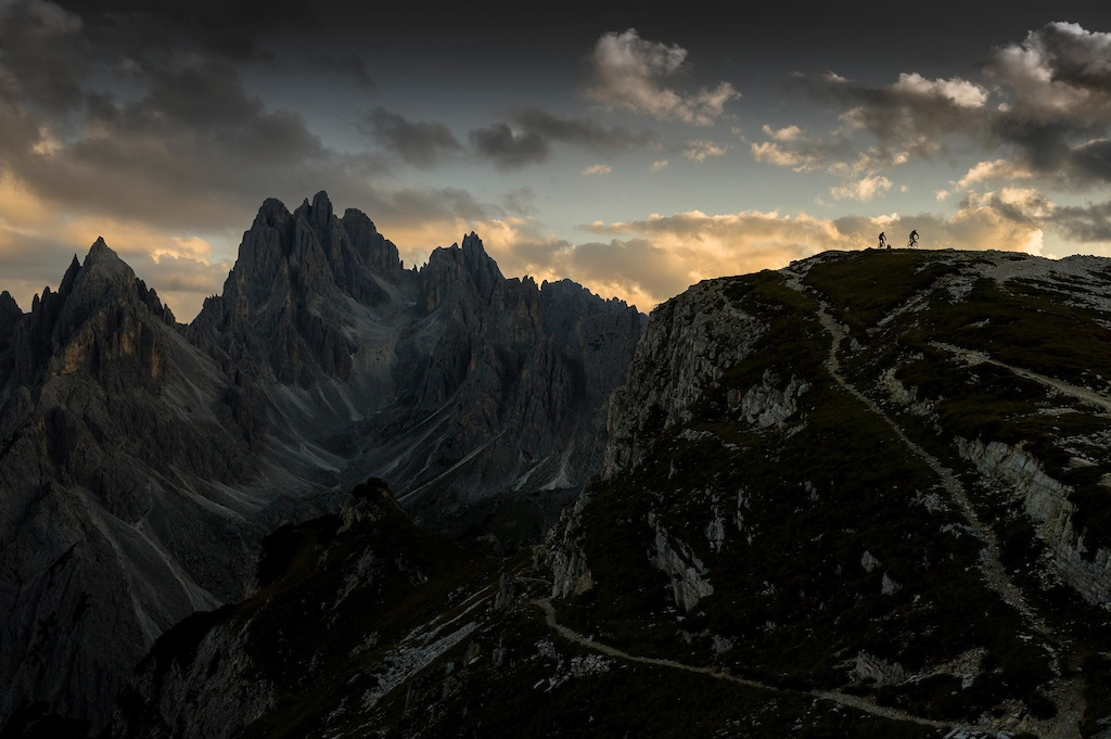 British professional endurance mountain bikers Rob Dean and Josh Ibbett on a late evening warm-down following their attempt to Mountain bike circumnavigate the challenging 90 Km Lavaredo Ultra Trail marathon running route Dolomites Italy.