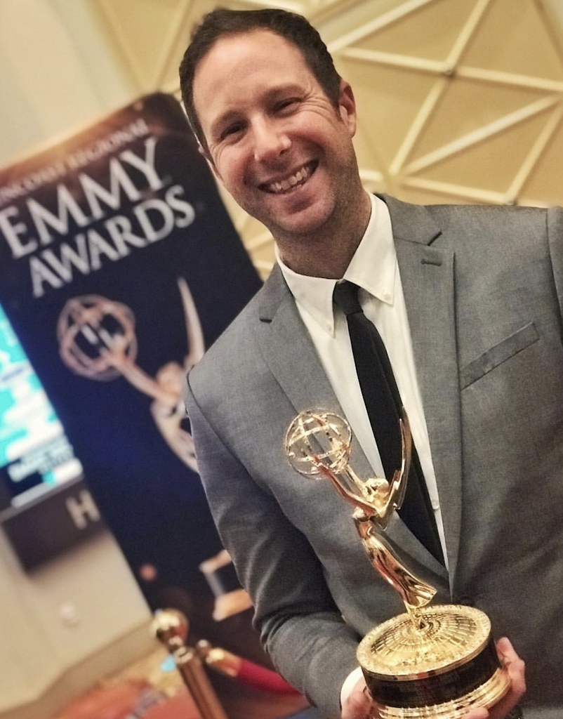 Director of Photography Matt Katsolis holding the Emmy for our film Volcanico.