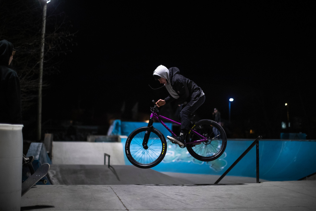 180 Bar off the bank. Riding a Chromag Monk, purple.