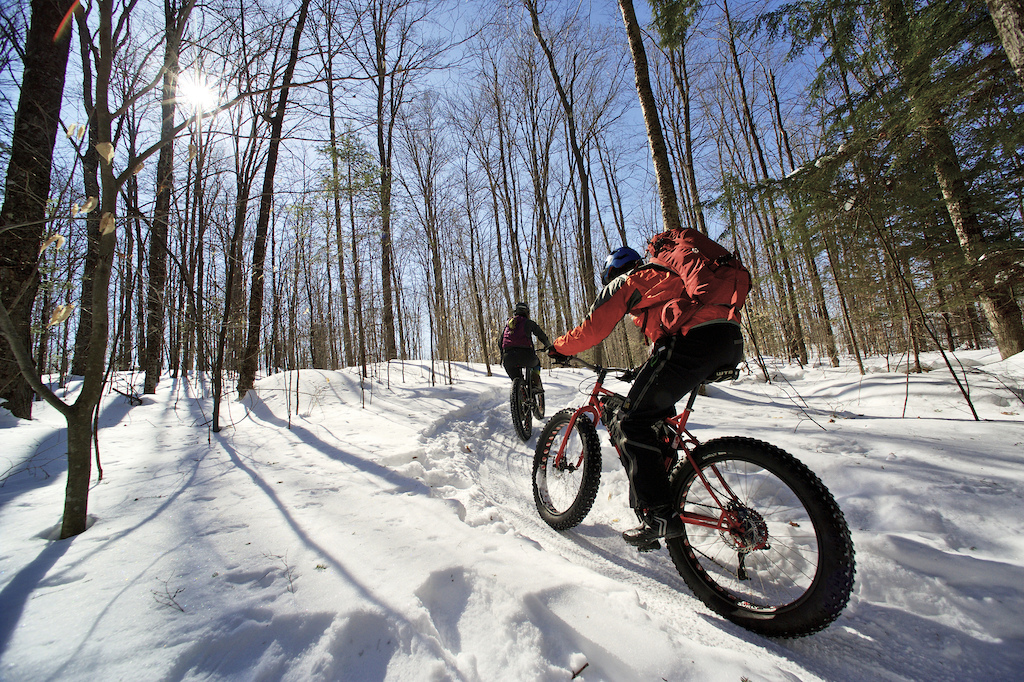 Fat bike riders at the 2015 WinterBike Festival at the Kingdom Trails East Burke Vermont on Saturday February 28 2015 photo by Bear Cieri