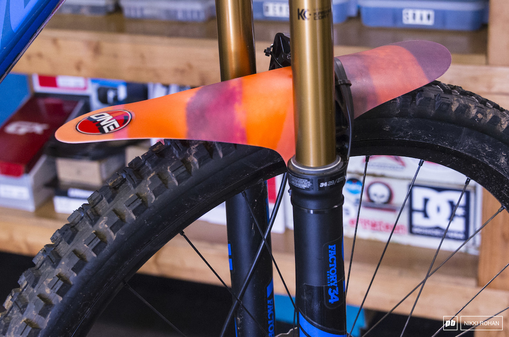 One Ball Large Colored Mountain Bike Mud Fork Fender mounted to a Fox 34 with 29 wheel Minion DHR II 2.4 WT