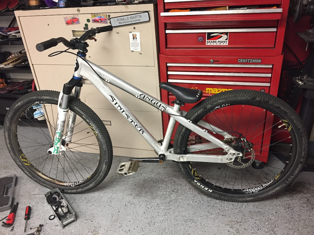 Before photos. Fork was shot aluminum was oxidized needed a little TLC. Fork rebuilt using existing parts inner foam was dry and super dirty . Removed spacers 80 mm travel currently . Repainted lower from white to black. Removed decal. Sanded buffed and polished frame. Painted cranks. Reinforced sliding dropouts the threads were stripping... used longer bolts and nuts to secure . New post and saddle blue to match headset .
