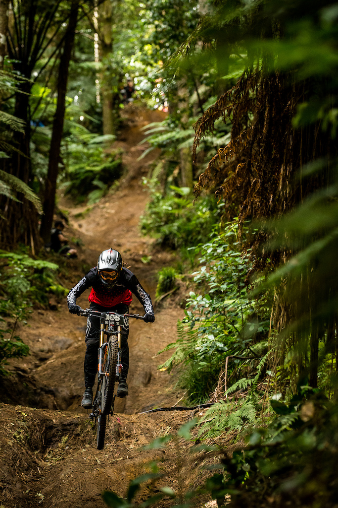 Vaea Verbeeck flying through the trees in the 2018 Crankworx Redwoods DH. Photo Boris Beyer