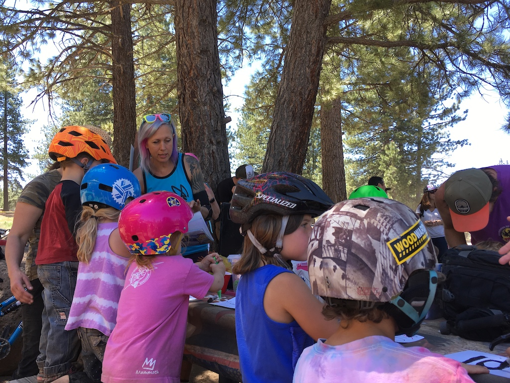 Kat Sweet helping the next generation make their number plates. Photo credit Lisa Mason